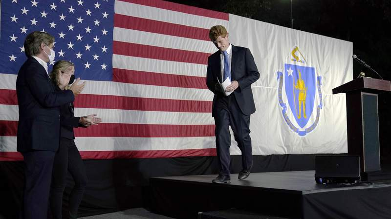 U.S. Rep. Joe Kennedy III leaves the stage after speaking outside his campaign headquarters in Watertown, Mass., after conceding defeat to incumbent U.S. Sen. Edward Markey, Tuesday, Sept. 1, 2020, in the Massachusetts Democratic Senate primary. Applauding at left are his twin brother Matthew and wife Lauren. (AP Photo/Charles Krupa)