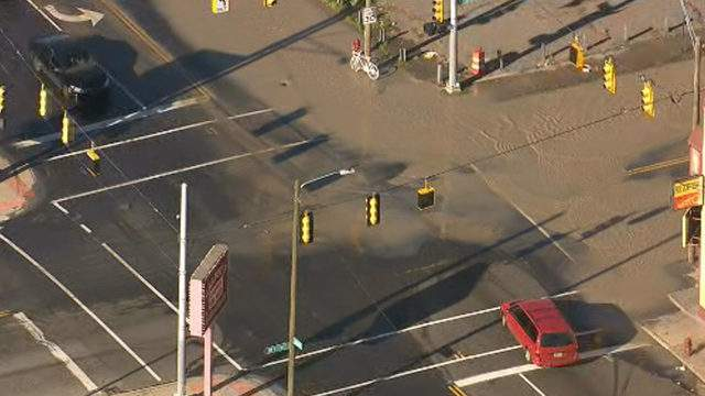 The corner of Mt. Elliott Street and Mack Avenue in Detroit was flooded after a water main break. (WDIV)