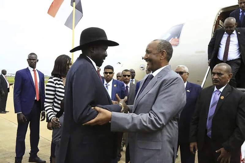 FILE - In this Oct. 14, 2019 file photo, provided by the official SUNA news agency, Gen. Abdel-Fattah Burhan, center right, head of Sudan's sovereign council, is greeted by South Sudan's President Salva Kiir, center left, as Sudan's new transitional government kicks off peace talks aimed at ending the country's yearslong civil wars, in Juba, South Sudan. The Sudan Revolutionary Front, a rebel alliance, and Sudans transitional authorities signed a peace deal Monday, Aug. 31, 2020, following months of negotiations in Juba. But other powerful armed groups have thus far declined to join them. (SUNA via AP, File)