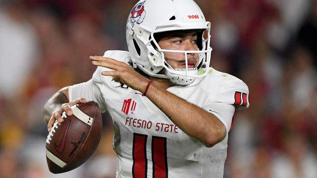 Jorge Reyna #11 of the Fresno State Bulldogs rolls out of the pocket during the game against the USC Trojans at Los Angeles Memorial Coliseum on August 31, 2019 in Los Angeles, California. (Photo by Harry How/Getty Images)