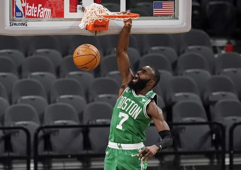 Boston Celtics guard Jaylen Brown (7) scores against the San Antonio Spurs during the second half of an NBA basketball game in San Antonio, Wednesday, Jan. 27, 2021. (AP Photo/Eric Gay)