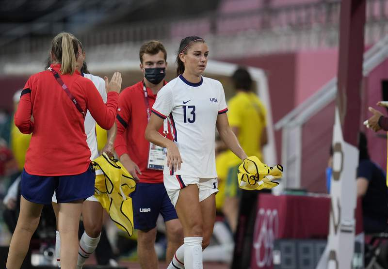 United States' Alex Morgan leaves the field during second half of a women's soccer match against Australia at the 2020 Summer Olympics, Tuesday, July 27, 2021, in Kashima, Japan. (AP Photo/Fernando Vergara)