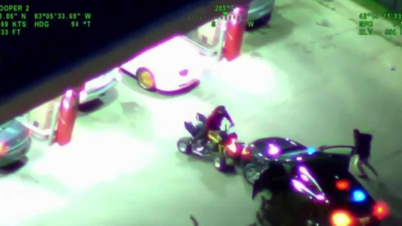 Video shows rider intentionally slamming ATV into police car