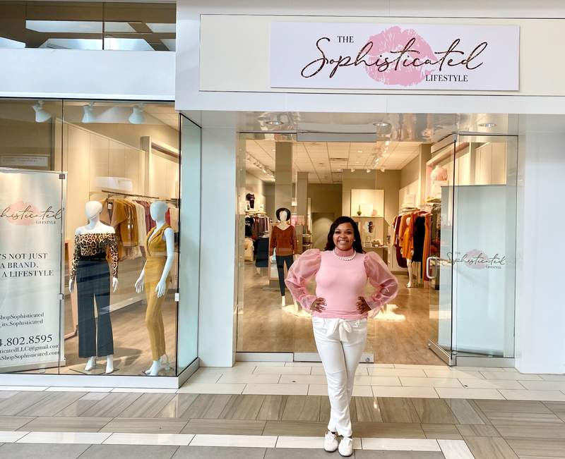 Pennie Bailey, the owner of The Sophisticated Lifestyle, in front of her Briarwood boutique.