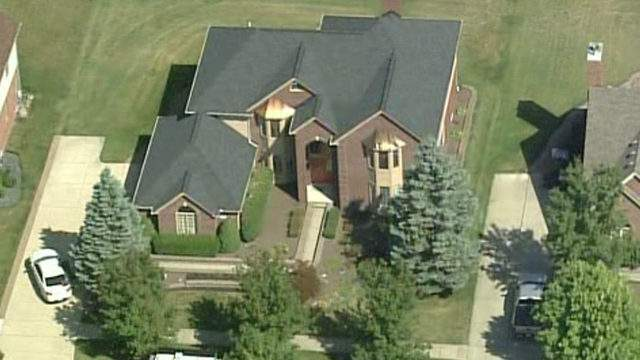 FBI agents raided a home in Canton Township on Aug. 28, 2019. (WDIV)