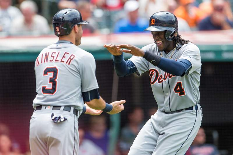 Ian Kinsler #3 celebrates with Cameron Maybin #4 of the Detroit Tigers after both scored on a double by Nick Castellanos #9 of the Detroit Tigers during the seventh inning against the Cleveland Indians at Progressive Field on July 6, 2016 in Cleveland, Ohio.