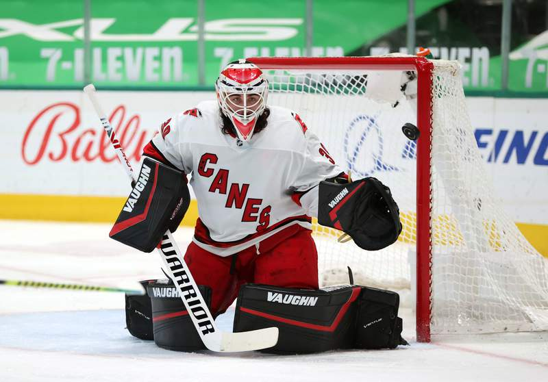 DALLAS, TEXAS - APRIL 27:  Alex Nedeljkovic #39 of the Carolina Hurricanes in goal against the Dallas Stars in the second period at American Airlines Center on April 27, 2021 in Dallas, Texas. (Photo by Ronald Martinez/Getty Images)