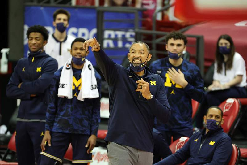 Head coach Juwan Howard of the Michigan Wolverines calls out to his team during the second half against the Wisconsin Badgers at Kohl Center on February 14, 2021 in Madison, Wisconsin.