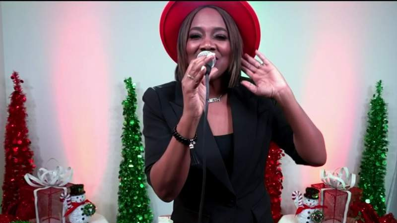 Beth Griffith-Manley sings a an original holiday song