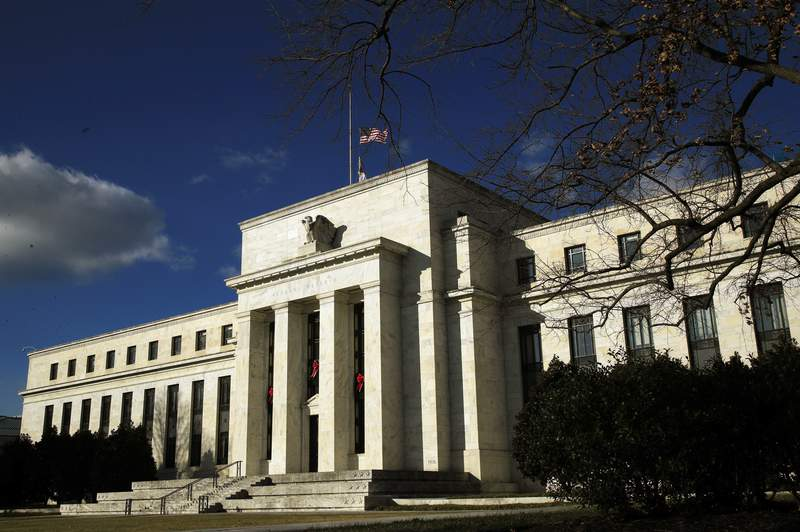 FILE - This Dec. 24, 2018, file photo shows the Federal Reserve building during a partial government shutdown in Washington. The Federal Reserve said Thursday, April 23, 2020, that it will provide monthly reports on several of its economic rescue programs supported by the $2 trillion rescue program passed by Congress. (AP Photo/Manuel Balce Ceneta, File)