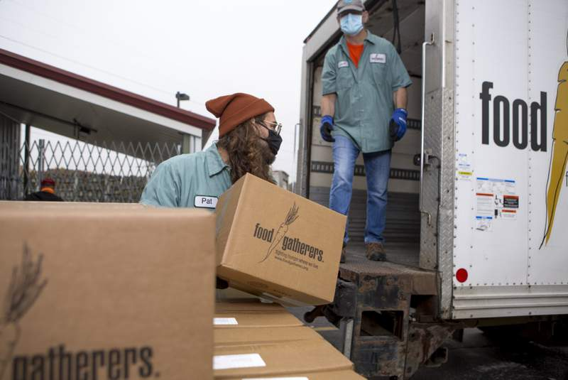 Food Gatherers team members load a truck full of emergency food boxes during the COVID-19 pandemic.