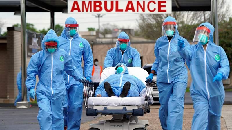 Coronavirus health care workers wearing hazmat suits