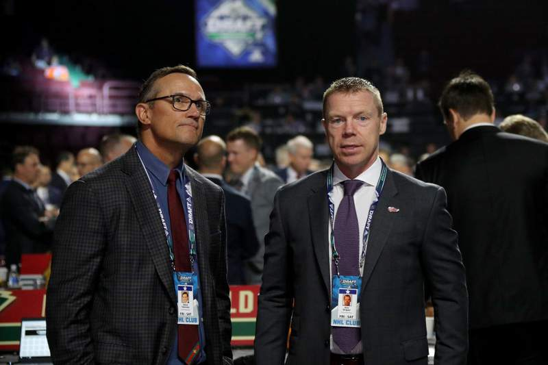 VANCOUVER, BRITISH COLUMBIA - JUNE 22: (L-R) Steve Yzerman and Kris Draper of the Detroit Red Wings attends the 2019 NHL Draft at Rogers Arena on June 22, 2019 in Vancouver, Canada. (Photo by Bruce Bennett/Getty Images)