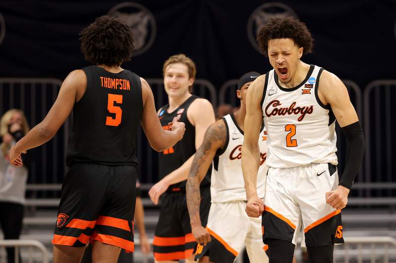 INDIANAPOLIS, INDIANA - MARCH 21: Cade Cunningham #2 of the Oklahoma State Cowboys reacts against the Oregon State Beavers during the second half in the second round game of the 2021 NCAA Men's Basketball Tournament at Hinkle Fieldhouse on March 21, 2021 in Indianapolis, Indiana. (Photo by Gregory Shamus/Getty Images)