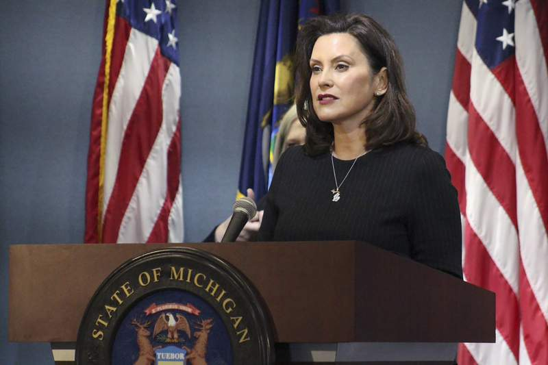 This photo provided by the Michigan Office of the Governor, Michigan Gov. Gretchen Whitmer addresses the state during a speech in Lansing, Mich., Wednesday, April 29, 2020. (Michigan Office of the Governor via AP, Pool)