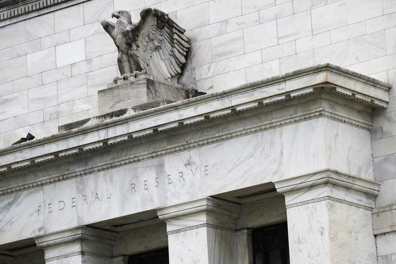 FILE - This May 22, 2020, file photo shows the Federal Reserve building in Washington. A Federal Reserve survey of business conditions around the country has found that the U.S. economy grew at a slight to modest pace in September 2020 and early October. (AP Photo/Patrick Semansky, File)