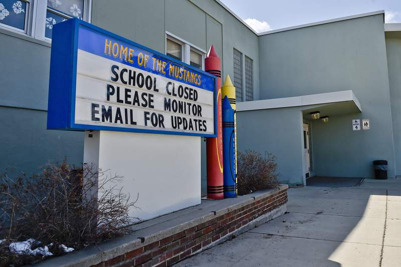 FILE - This Thursday, April 16, 2020 file photo shows a sign announcing an elementary school in Helena, Mont., is closed. When the coronavirus pandemic took hold across the United States in mid-March, forcing schools to close and many children to be locked down in households buffeted by job losses and other forms of stress, many child-welfare experts warned of a likely surge of child abuse. Fifteen weeks later, the worries persist  yet some experts on the front lines, including pediatricians who helped sound the alarm, say theyve seen no evidence yet that a marked increase has taken place. (Thom Bridge/Independent Record via AP)