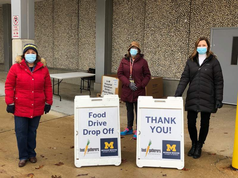 Volunteers wait to accept donations for Michigan Medicine and Food Gatherer's food drive in December 2020.