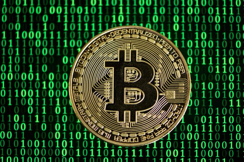 The photo shows a physical imitation of a Bitcoin in Dortmund, western Germany, on January 27, 2020. (Photo by INA FASSBENDER / AFP) (Photo by INA FASSBENDER/AFP via Getty Images)