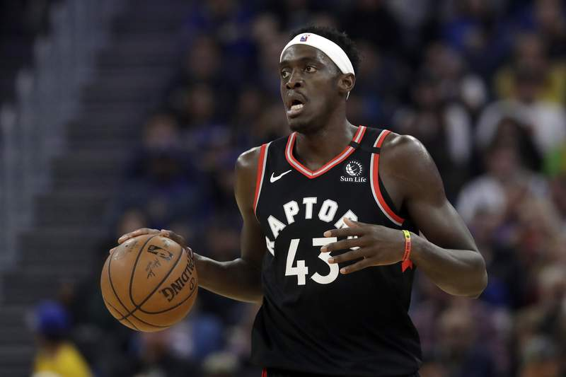 FILE - In this March 5, 2020, file photo, Toronto Raptors forward Pascal Siakam (43) dribbles against the Golden State Warriors during an NBA basketball game in San Francisco. (AP Photo/Jeff Chiu, File)