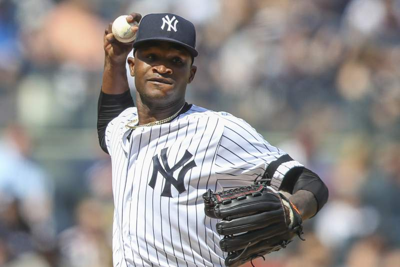 FILE - In this Aug. 31, 2019, file photo, New York Yankees pitcher Domingo German throws to first in a pickoff-attempt during the fifth inning of a baseball game against the Oakland Athletics in New York. German has started the process of talking to teammates about his domestic violence suspension that has kept him off the mound since September 2019. (AP Photo/Mary Altaffer, File)