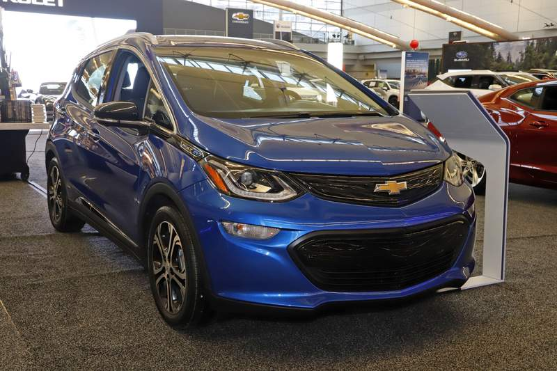 FILE - This Thursday, Feb. 13, 2020 file photo shows a 2020 Chevrolet Bolt EV on display at the 2020 Pittsburgh International Auto Show  in Pittsburgh. General Motors is recalling all Chevrolet Bolt electric vehicles sold worldwide to fix a battery problem that could cause fires. The recall raises questions about lithium ion batteries, which now are used in nearly all electric vehicles. President Joe Biden wants to convert 50% of the U.S. vehicle fleet from internal combustion to electricity by 2050 as part of a broader effort to fight climate change. The recall was announced Friday, Aug. 20, 2021. (AP Photo/Gene J. Puskar)