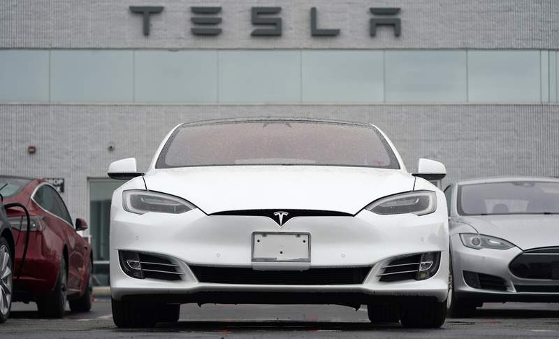 FILE - This Sunday, May 9, 2021 file photo shows vehicles at a Tesla location in Littleton, Colo. Tesla delivered 201,250 vehicles in the second quarter, an improvement over first-quarter figures but below the expectations of Wall Street analysts. Tesla and other automakers have been hampered by a global shortage of computer chips. (AP Photo/David Zalubowski)