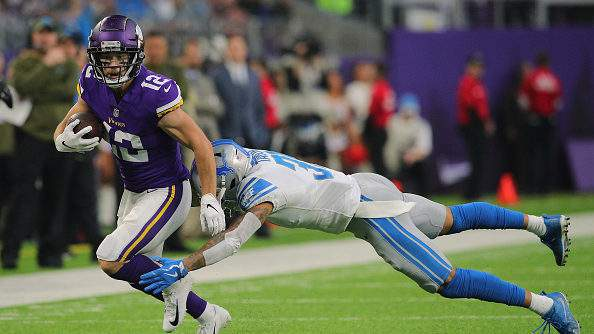 MINNEAPOLIS, MN - NOVEMBER 4: Chad Beebe of the Minnesota Vikings carries the ball for a gain while Teez Tabor #31 of the Detroit Lions attempts the tackle in the first quarter at U.S. Bank Stadium on November 4, 2018 in Minneapolis, Minnesota. (Photo by Adam Bettcher/Getty Images)