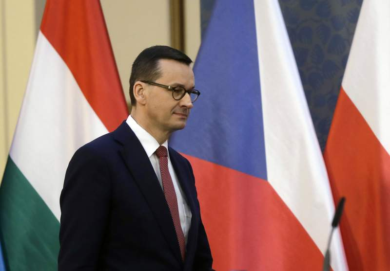 FILE - In this file photo dated Wednesday, March 4, 2020, Prime Minister of Poland Mateusz Morawiecki arrives for a press conference during a V-4 summit in Prague, Czech Republic.  Morawiecki said Wednesday April 29, 2020, that Poland's presidential election must be held in May despite the coronavirus pandemic, but the May 10 date of the vote may be pushed back by a week or two. (AP Photo/Petr David Josek, FILE)