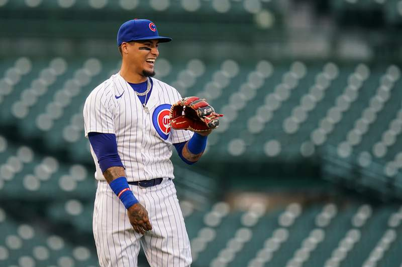 Javier Baez #9 of the Chicago Cubs looks on and laughs against the Minnesota Twins during an exhibition game at Wrigley Field on July 22, 2020 in Chicago, Illinois.