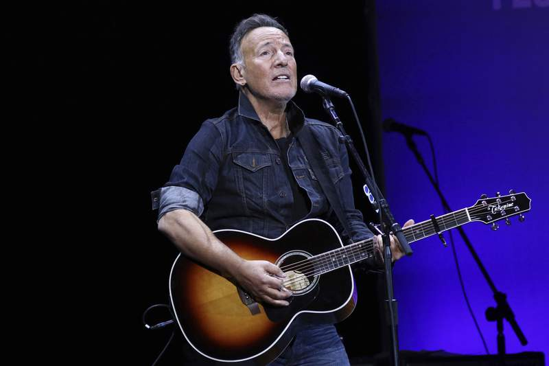 FILE - Bruce Springsteen performs at the 13th annual Stand Up For Heroes benefit concert in support of the Bob Woodruff Foundation in New York on Nov. 4, 2019. Springsteen is this year's winner of the Woody Guthrie Prize. The award honors artists of any medium who continue the legacy of the Oklahoma songwriter. Springsteen calls Guthrie one of his most important influences. The legendary performer will be honored in a virtual ceremony May 13.  (Photo by Greg Allen/Invision/AP, File)