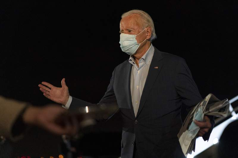 Democratic presidential candidate former Vice President Joe Biden speaks to the media as he arrives at New Castle Airport, Saturday, Oct. 10, 2020, in New Castle, Del., as he returns from Erie, Pa. (AP Photo/Carolyn Kaster)