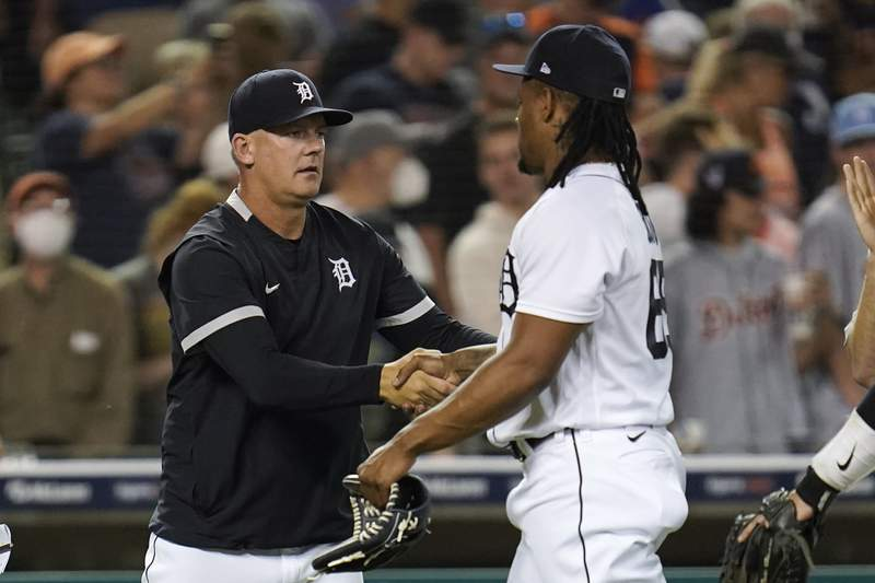 Detroit Tigers manager A.J. Hinch congratulates Gregory Soto after a baseball game against the Boston Red Sox in Detroit, Tuesday, Aug. 3, 2021. Detroit won 4-2.