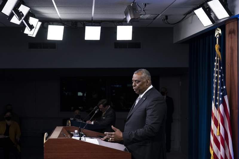Secretary of Defense Lloyd Austin speaks during a media briefing at the Pentagon, Friday, Feb. 19, 2021, in Washington. (AP Photo/Alex Brandon)