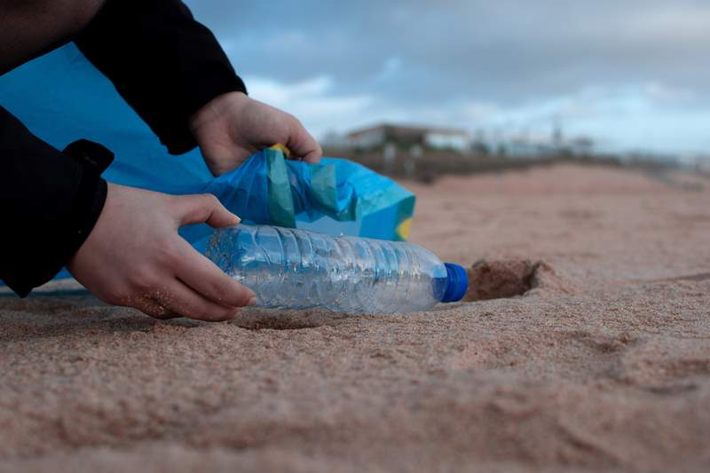 Picking up trash on a beach or in a park is something good you can do for your community.
