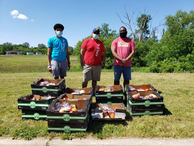 Ann Arbor YMCA staff distribute free produce boxes to those in need in the community in July 2020.