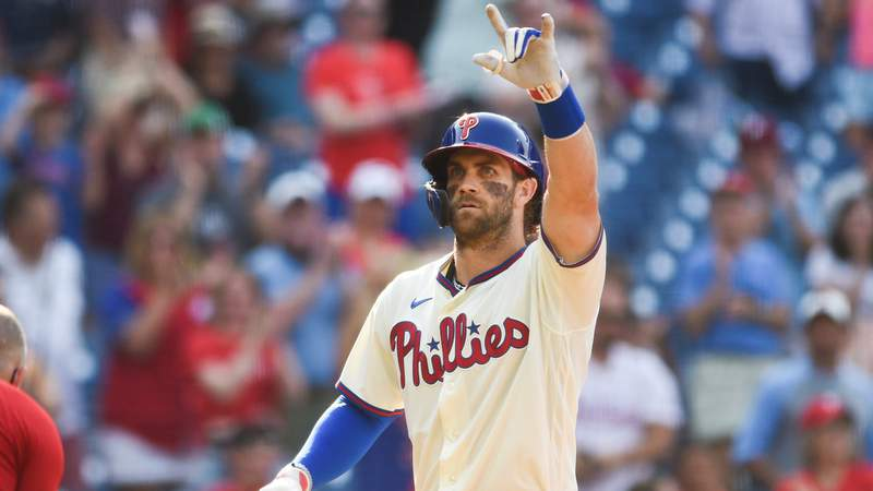 Bryce Harper #3 of the Philadelphia Phillies celebrates after hitting a solo home run against the Colorado Rockies in the eighth inning at Citizens Bank Park on September 12, 2021 in Philadelphia, Pennsylvania.