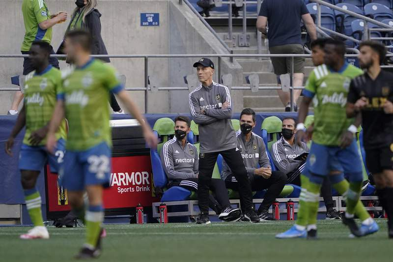 Los Angeles FC head coach Bob Bradley watches from the sideline during the second half of an MLS soccer match against the Seattle Sounders, Sunday, May 16, 2021, in Seattle. The Sounders won 2-0. (AP Photo/Ted S. Warren)