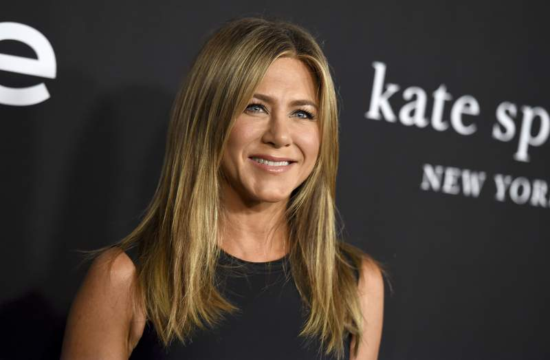 """FILE - Jennifer Aniston arrives at the fourth annual InStyle Awards on Oct. 22, 2018, in Los Angeles. Aniston is among the celebrities taking part in an Aug. 20 virtual reading of the script for 1982's Fast Times at Ridgemont High"""" as an online fundraiser. (Photo by Jordan Strauss/Invision/AP, File)"""