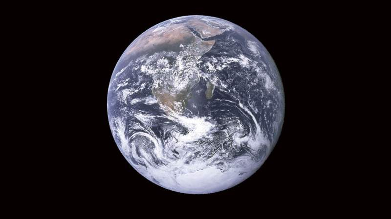 """""""The Blue Marble"""" is a famous photograph of the Earth taken on December 7, 1972 by the crew of the Apollo 17 spacecraft en route to the Moon at a distance of about 29,000 kilometers (18,000 statute miles)."""