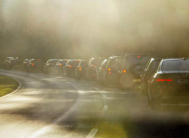 """FILE-In this Oct. 31, 2018 file photo people queue in a traffic jam when commuting to Frankfurt, Germany. The European Union's top court ruled Thursday that Germany systematically and persistently"""" exceeded limits on nitrogen dioxide, a harmful gas produced by diesel engines, in many regions between 2010 and 2016.(AP Photo/Michael Probst, file)"""
