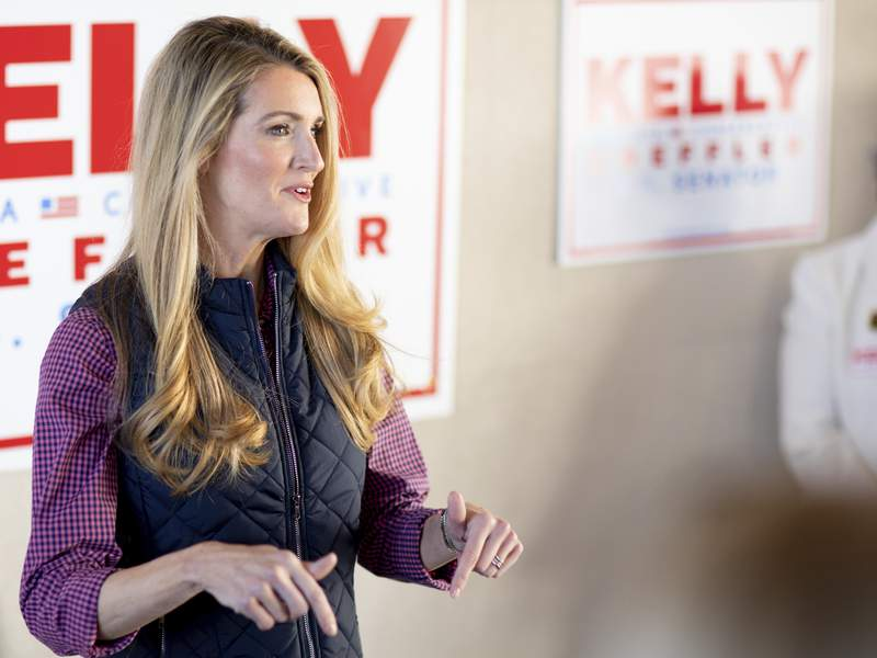Sen. Kelly Loeffler, R-Ga., who is running for reelection, speaks to the media at Cobb County International Airport on Election Day, Tuesday, Nov. 3, 2020, in Kennesaw, Ga. (AP Photo/Branden Camp)