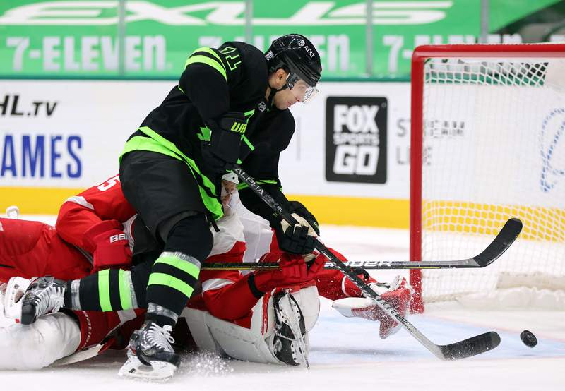 DALLAS, TEXAS - JANUARY 28:  Andrew Cogliano #11 of the Dallas Stars scores a goal against Jonathan Bernier #45 of the Detroit Red Wings in the second period at American Airlines Center on January 28, 2021 in Dallas, Texas. (Photo by Ronald Martinez/Getty Images)