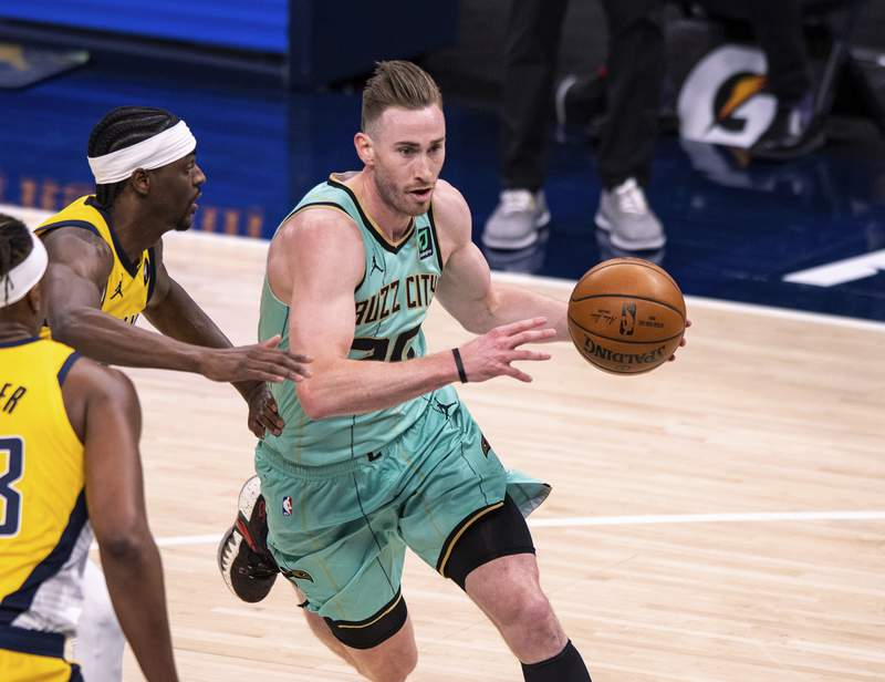 Charlotte Hornets forward Gordon Hayward (20) drives to the basket during the first half of the team's NBA basketball game against the Indiana Pacers in Indianapolis, Friday, April 2, 2021. (AP Photo/Doug McSchooler)