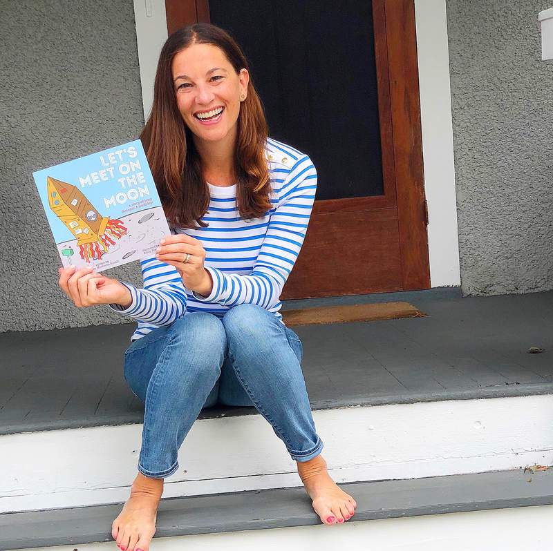 """Self-published children's author Lauren Ranalli with her latest book, """"Let's Meet on the Moon."""""""