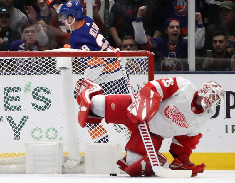 JANUARY 14: Brock Nelson #29 of the New York Islanders scores on Jimmy Howard #35 of the Detroit Red Wings at 7:56 of the first period at NYCB Live's Nassau Coliseum on January 14, 2020 in Uniondale, New York.