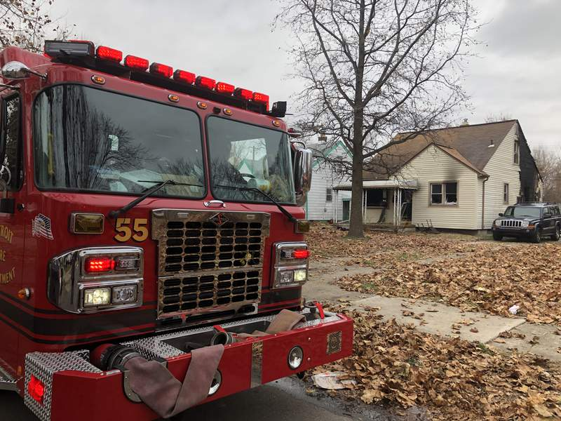 Firefighters pulled a woman and child from a house fire Dec. 8, 2020 in the 7400 block of Clayburn Street in Detroit.