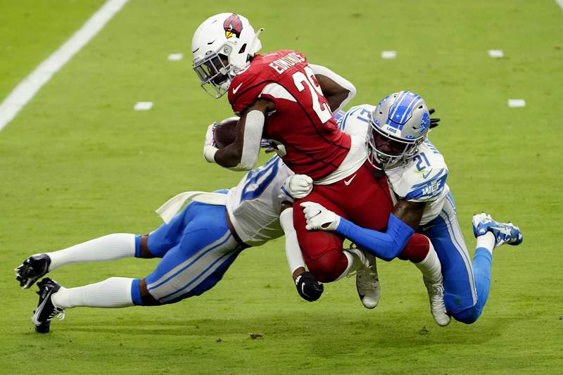 Arizona Cardinals running back Chase Edmonds (29) is hit by Detroit Lions defensive back Tracy Walker (21) andcornerback Jeff Okudah during the first half of an NFL football game, Sunday, Sept. 27, 2020, in Glendale, Ariz. (AP Photo/Rick Scuteri)