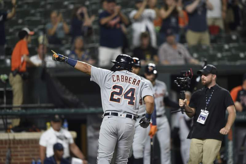 Detroit Tigers Miguel Cabrera points to family after hitting his 499th home run during the fifth inning of a baseball game against the Baltimore Orioles, Wednesday, Aug. 11, 2021, in Baltimore.