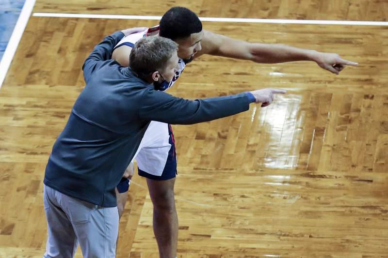 Gonzaga guard Jalen Suggs (1) and head coach Mark Few discuss strategy during the second half of an NCAA college basketball game against Iowa, Saturday, Dec. 19, 2020 in SIoux Falls, S.D. (AP Photo/Josh Jurgens)